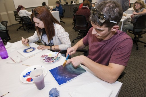 Students and community members expressed themselves on canvas during a Paint Your Personality event in honor of Mental Health Awareness Week. (Photo by Erin Pence)