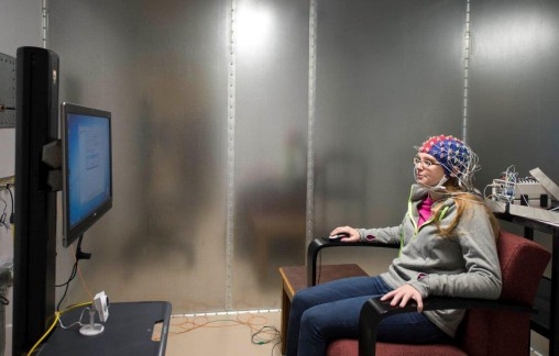 Psychology student Jackie Ewald prepares to view images during an experiment in the new cognitive neuroscience lab.