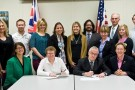 Stephen Foster, Wright State's associate vice president for international affairs, from row second from right, and Helen Valentine, deputy vice chancellor of Anglia Ruskin University in England, front row third from right, at a ceremony that formalized the partnership between the two universities in 2013. They are flanked by Wright State officials and members of the Anglia Ruskin delegation.