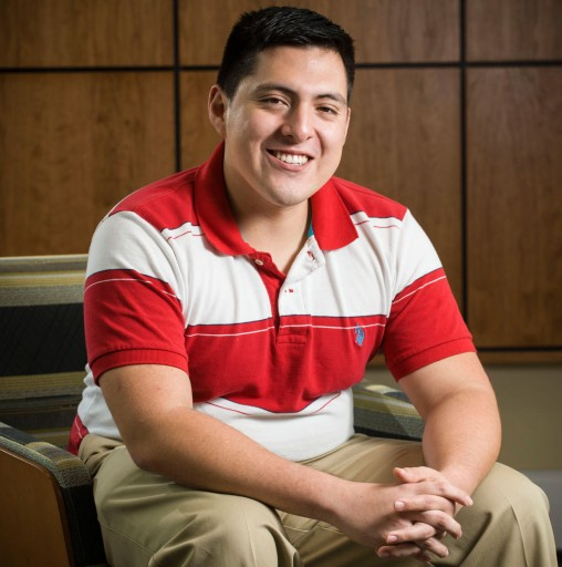 Wright State business graduate Juda Medina '14 turns internship into full-time job as he focuses his career on global business. (Photo by Erin Pence)