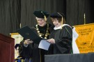 Wright State President David R. Hopkins presents Sharon Honaker Rab '75 with a an honorary Doctorate of Humane Letters during Wright State's commencement ceremony at Nutter Center Dec. 19.