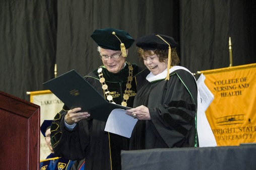 Wright State President David R. Hopkins presentsSharon HonakerRab '75 with a an honorary Doctorate of Humane Letters during Wright State's commencement ceremony at Nutter Center Dec. 19.