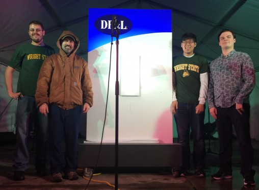 From left: Wright State student Laynce Yoder, DP&L employee Michael Dornbursch and Wright State students Jeremy Hong and John Richard at the Grande Illumination Ceremony on Courthouse Square in Dayton.