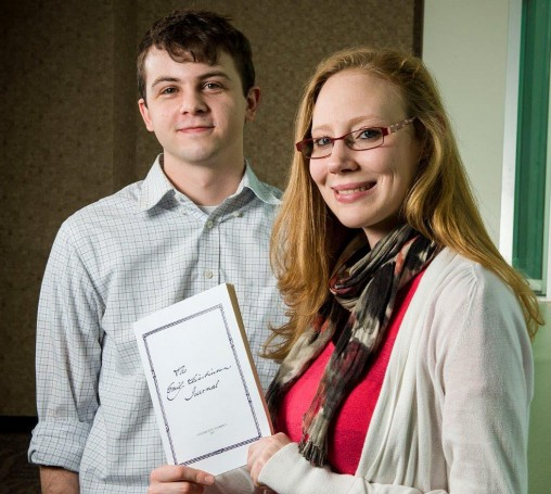 "Graduate English students Sebastian Williams, left, and Sonora Humphreys serve as managing editors of ""The Emily Dickinson Journal,"" which is published by Wright State's Department of English Language and Literatures. (Photos by Erin Pence)"