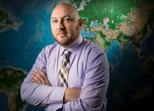 Joshua Cummins, who has degrees in history and international and comparative politics from Wright State, received first-hand lessons on the Persian Gulf nation of Qatar during a fellowship. (Photo by Erin Pence)
