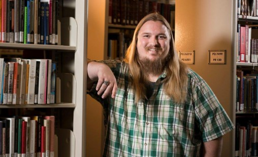 Wright State senior Matt Garrett shines in the university's creative writing program, inspired by magic, monsters and wizards from the fantasy genre. (Photo by Will Jones)