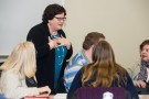 Susan Lightle, professor of accountancy, meets with Master of Accountancy students during a recent class. (Photo by Erin Pence)