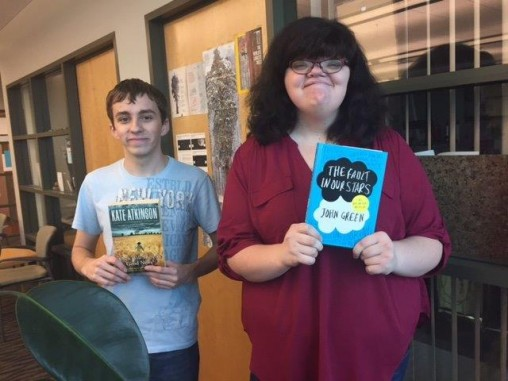 From left, students Dylan Ward and Courtney Cattell worked with English instructor Carolyn Stoermer to purchase books for the prison using proceeds from the English Club's used-book sale. (Contributed photo)