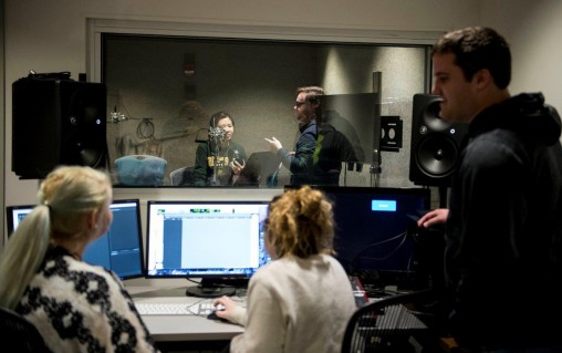 Students in the production studio at the newly renovated Center for Motion Pictures. From left in foreground, E.R. Dickey, Kara Lynch and Nick Kutskill. (Photo by Will Jones)