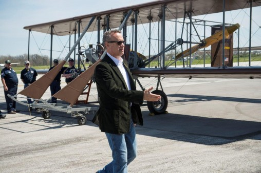 "Tom Hanks with Wright ""B"" Flyer at the Dayton-Wright Brothers Airport. (Photo by Will Jones)"
