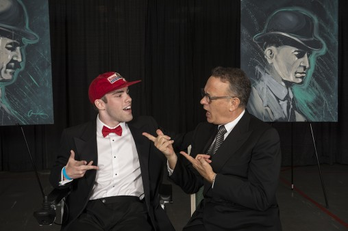 Motion pictures student William Crotty joking around with Tom Hanks at the gale celebrating the success of the Rise. Shine. Campaign. (Photo by Will Jones)