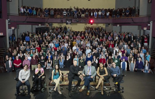 """Tom Hanks, center, and Wright State Theatre, Dance, and Motion Pictures department chair and friend W. Stuart McDowell pose for a picture with performing arts students after a """"Talk Back"""" event with Hanks in the Festival Playhouse. (Photo by Will Jones)"""