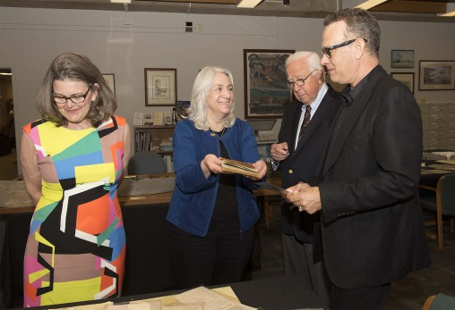 "Dawne Dewey, head of Special Collections and Archives at Wright State, showed items from the university's ""Wright Brothers Collection"" to David McCullough, Tom Hanks and Amanda Wright Lane, great-grandniece of the Wright brothers. (Photo by Will Jones)"