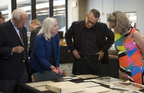 "Dawne Dewey, head of Special Collections and Archives at Wright State, second from left, showed items from the university's ""Wright Brothers Collection"" to writer David McCullough, left, Tom Hanks and Amanda Wright Lane, great-grandniece of the Wright brothers. (Photo by Will Jones)"