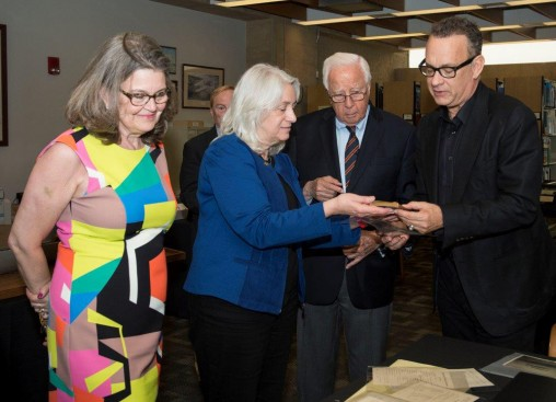 "Dawne Dewey, head of Special Collections and Archives at Wright State, showed items from the university's ""Wright Brothers Collection"" to David McCullough, Tom Hanks and Amanda Wright Lane. (Photo by Will Jones)"