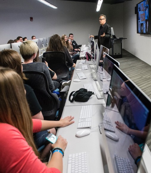 Tom Hanks talking with film students during a tour of the Center for Motion Pictures. (Photo by Will Jones)