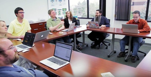 The Wright State University Office Of Marketing web team at work. The team includes, clockwise from left: Jesse Gifford, Amanda Earnest, Nate Jorgensen, Kyle O'Brien, Cassie McKinney, Mark Anderson and Chase Cathcart.