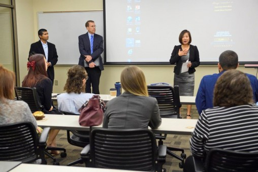 Addressing the teams of marketing students on the debate project are, from right, Joanne Li, dean of the Raj Soin College of Business; Kendall Goodrich, chair of the Department of Marketing; and Kunal Swani, assistant professor of marketing. (Photo by Erin Pence)