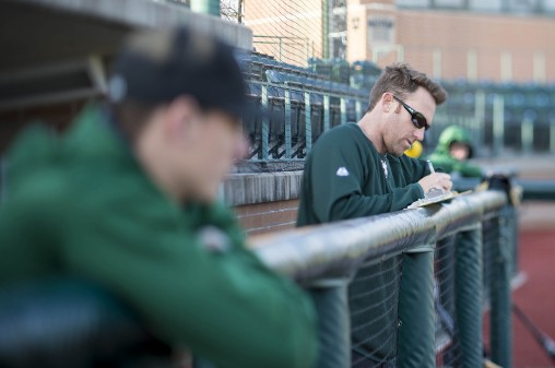 Coach Greg Lovelady taking notes during a recent practice.