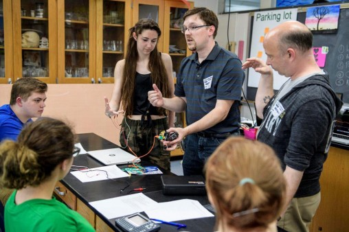 Wright State neuroscience professors Patrick Sonner, center, and Christopher Wyatt, right, conduct a demonstration at Yellow Springs High School with sophomore Kallyn Buckenmyer. (Photo by Erin Pence)