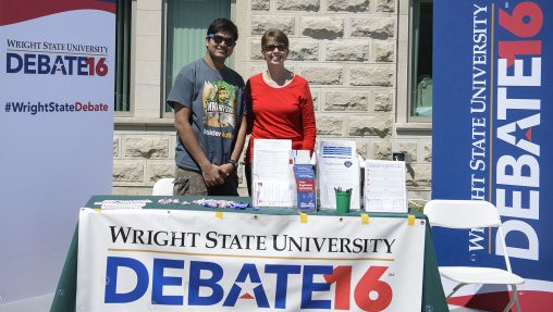 Graduate student Nathan Balasubramanian and Barbara Allbright, from the Office of Student Support Services, volunteered at the Debate information table during April Craze on campus.