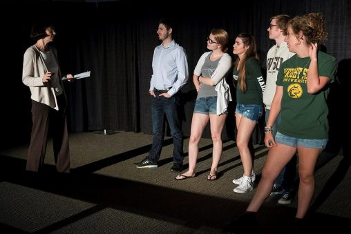 Kathrin Engisch, interim dean of the College of Science and Mathematics, left, works with theatre students doing improv for incoming freshmen during Raider Academy. (Photo by Erin Pence)