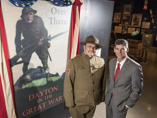 "Paul Lockhart, left, professor of history, and Brady Kress '96, Carillon Historical Park president and CEO, helped organize ""Over There: Dayton and the Great War,"" now on display at Carillon Historical Park. (Photo by Erin Pence)"