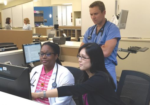 Wright State has been awarded more than $450,000 to train future clinicians to work in a multidisciplinary team environment. From left, Ariana Herbert, Robert Petro and Tracy Fong, medical residents in the Wright State Family Medicine Residency Program at Five Rivers Family Health Center, collaborate on patient care.
