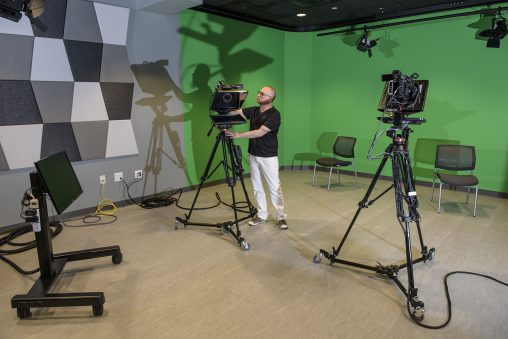 The New Media incubator features a working television and film studio with professional cameras and control room where students can manipulate and monitor studio events.