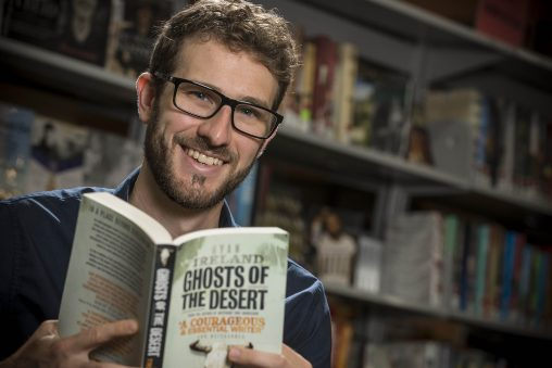 """Wright State graduate Ryan Ireland's latest novel, """"Ghosts of the Desert,"""" is based on real-life events highlighting Stockholm syndrome, institutionalized power and the fading history of the American West. (Photos by Chris Snyder)"""