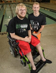 Jacob Huff, left, and Cameron Moon train together as part of Adapted Recreation's Workout Buddy Program. (Photo by Erin Pence)