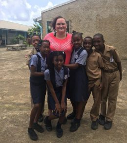 During a study abroad and service-learning trip to Jamaica, Katie Schmidt taught students singing and how to play the recorder.