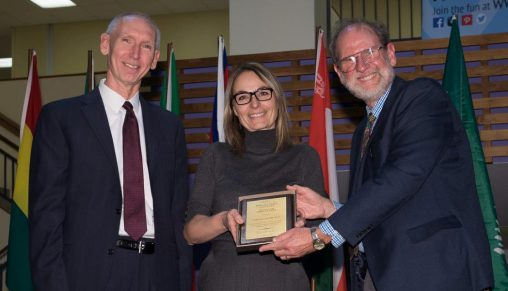 Pascale Abadie, assistant professor of French, accepted the 2016 International Education Award from Provost Thomas Sudkamp, left, and Henry Limouze, interim associate vice president for international affairs. (Photo by Erin Pence)