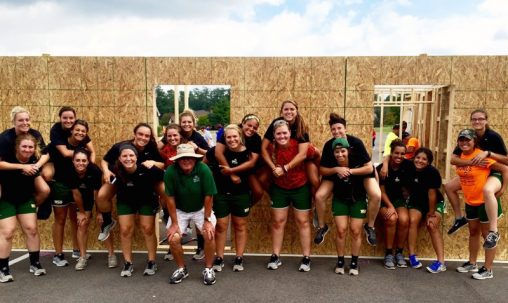 The Wright State softball team pitches in to help build a home for Habitat for Humanity in September.