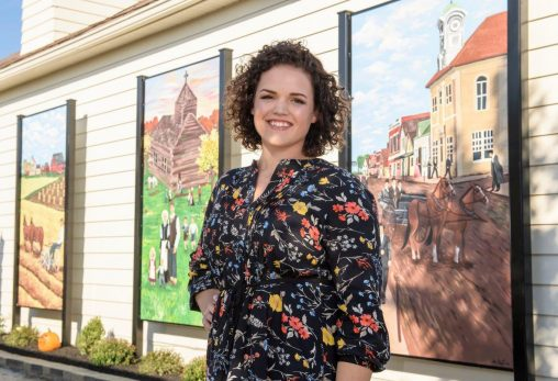 Wright State art major Katelyn Puthoff produced a colorful, three-paneled mural depicting the history of her hometown of Minster. (Photos by Erin Pence)