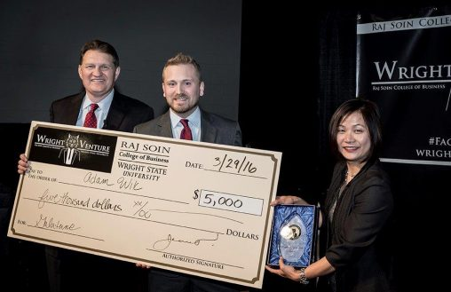 Adam Wik won the 2016 Wright Venture competition. He is pictured with Barry James, president, CEO and portfolio manager of James Investment Research, and Joanne Li, dean of the Raj Soin College of Business. (Photo by Will Jones)