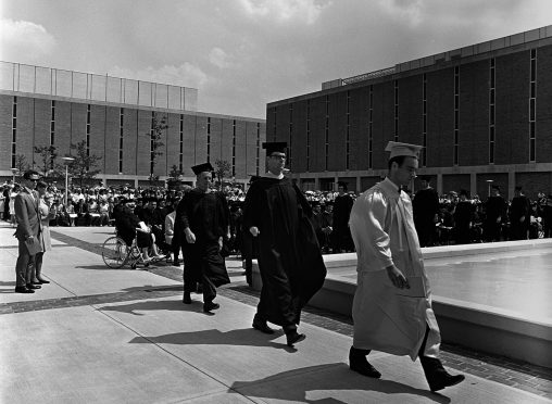 Wright State's 50th anniversary celebration includes a new website ; the publication of a book on the university's history; and a special Homecoming Sept. 29 through Oct. 1. Pictured here are Students at Wright State's first commencement held on the Quad in 1968.