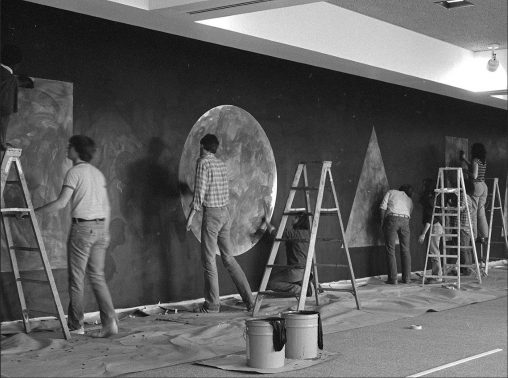 Artists installing a Sol LeWitt wall drawing in Wright State's Rike Hall in 1981.