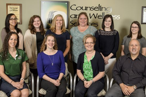 Robert Rando, right front row, with members of the Counseling and Wellness Services staff.