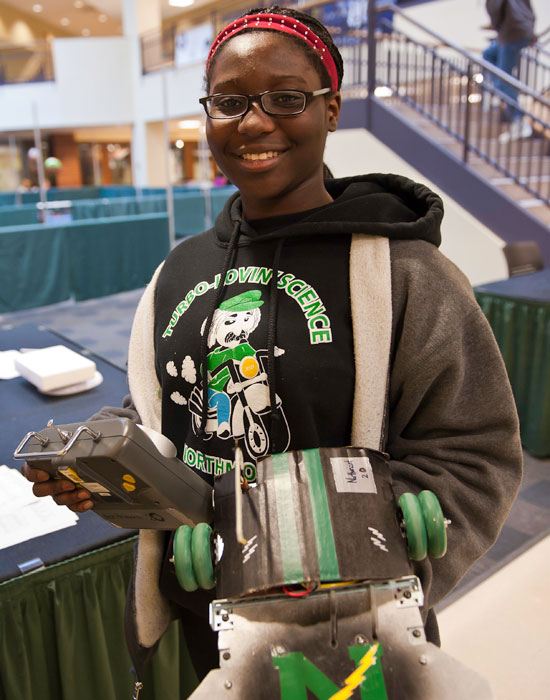 """Nana Anim competed in the """"Sumo Bots"""" event. Her goal was to use her homemade robot to push another team's robot out of a square drawn on the floor in red tape."""
