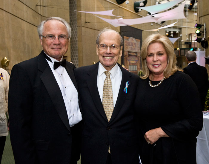 Wright State President David R. Hopkins and his wife, Angelia, welcomed arts patron Benjamin Schuster (center).