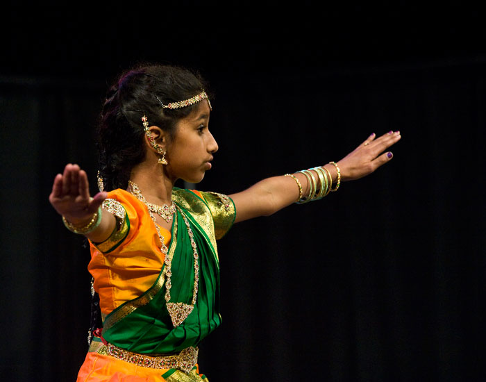 Photo of a dancing student in Indian garb.