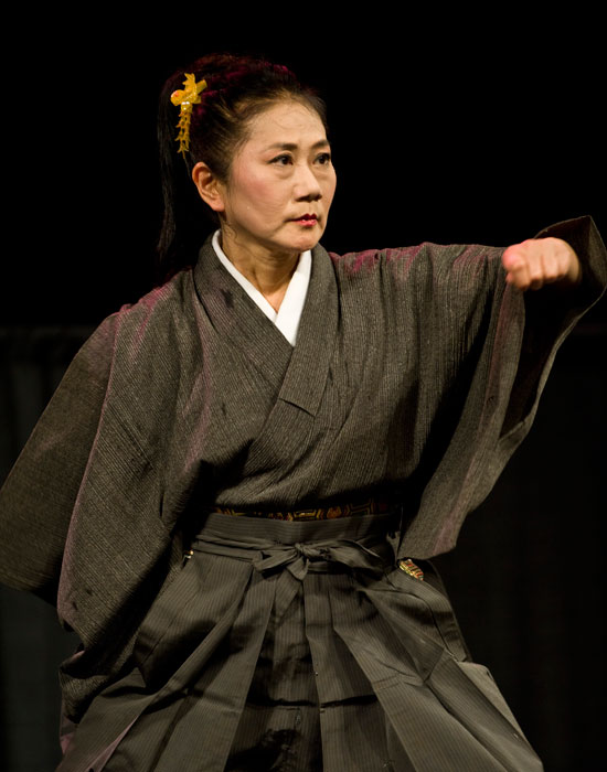 Photo of a Japanese performer doing traditional martial arts.