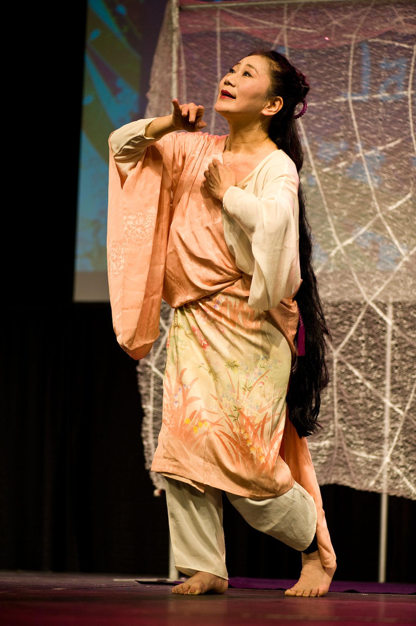 Photo of an Asian woman dancing.