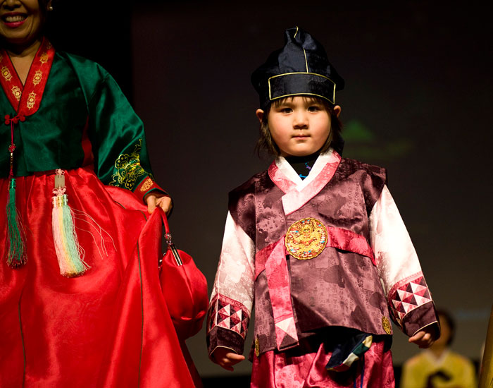 Photo of a young boy in traditional Korean dress.