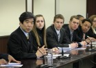 Wright State students from Model UN team sitting next to Japnese Ambasador for question and answer session