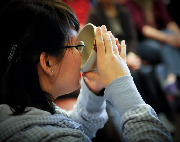 Photo of a student drinking a cup of tea.