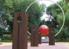 Photo of the project with planetary monoliths in the foreground and the Sun sculpture in the background.
