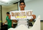 Photo of Paraj Arora showing off his Diamonback roller coaster he made in a pre-college camp.