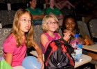 "Photo of Stella Joly, Kaylee Gleason and Olivia James watching the ""Discovery Video"" camp's highlights of the week."